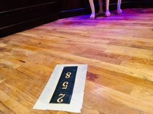 """In-game: The number """"2 5 8"""" mounted to the floor."""