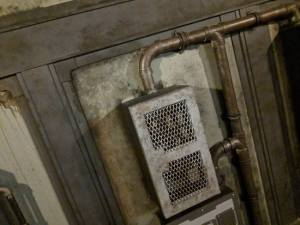 In-game: a metal box connected by pipes.