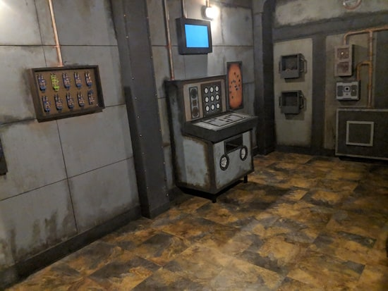In-game: A a series of switches, and a large control panel.