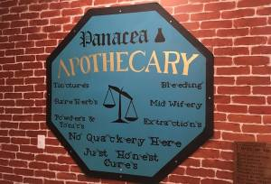 In-game: The sign for the Panacea Apothecary in the hallway of Room Escapers.