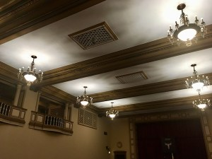 In-game: The ceiling of the ballroom features beautiful woodwork and intricate light fixtures.