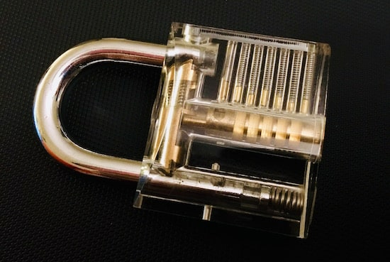 A transparent lock displaying all of its inner mechanisms.