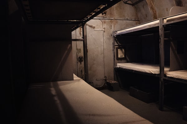 In-game: wide angle of a the bunks in the submarine.