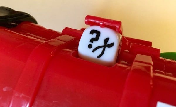 The dice attached to the back of the bomb.