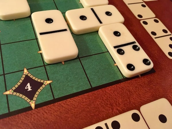 Closeup showing how the dominoes cover the color of a point tile.