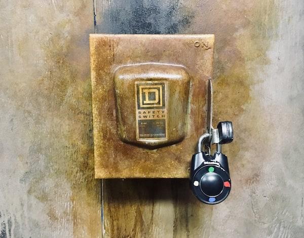 In-game: Closeup of a large electrical safety switch locked up a directional lock.