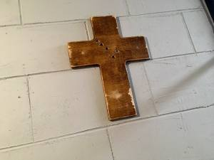 In-game: A cross hanging on a concrete wall.