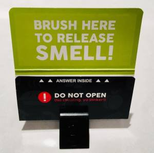 A smell card with instructions where to scratch.