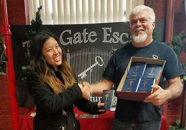 Audrey giving Rene his box of passports at Gate Escape.