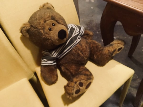 In-game: A big stuffed teddy bear sitting on a chair.