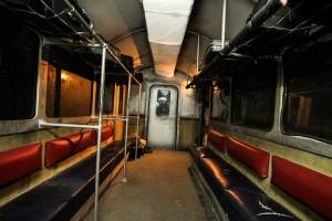 In-game: In-game: A weathered and damaged subway car.