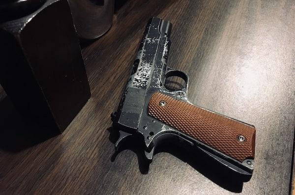 In-game: a worn Colt M1911 pistol.