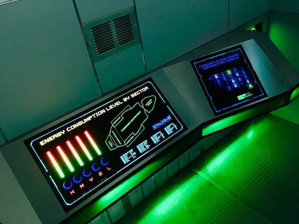 In-game: The glowing energy consumption level by sector console.