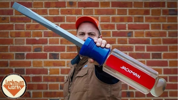 Man holding a massive screwdriver.