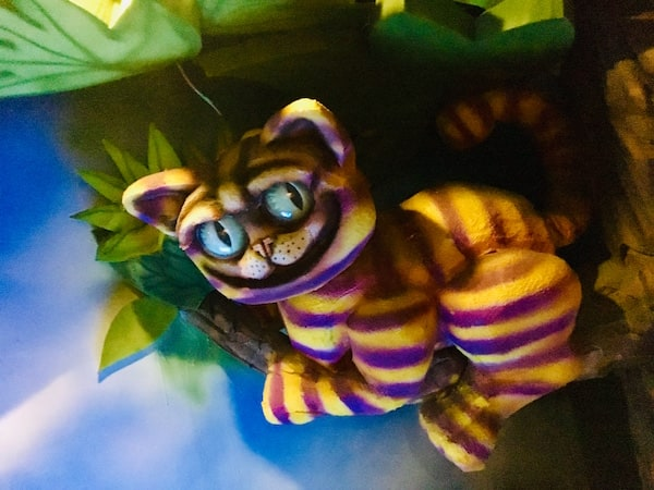 In-game: The Cheshire Cat hanging out in a tree.