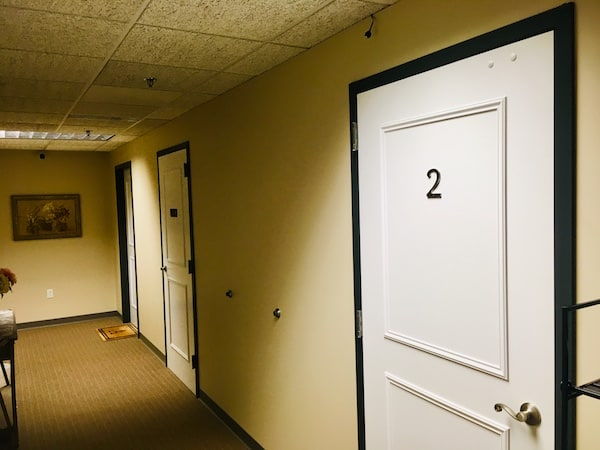 In-game: The hallway for an apartment building.
