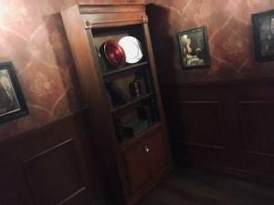In-game: A bookshelf in an elegant study.