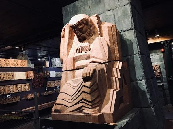 A massive art deco sculpture of a man.