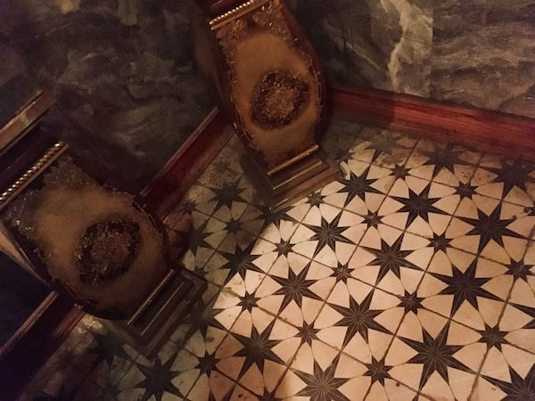 In-game: The ornate yet dusty tile floor.