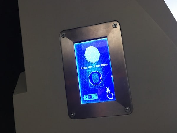 In-game: A fingerprint scanner mounted to the wall.