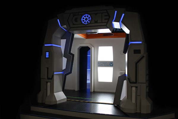 """In-game: The entry way for The Dome opened, a sign reads, """"Butterfly Safe Zone.""""."""