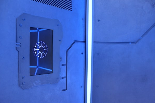 In-game: A screen mounted into the steel wall of The Dome.