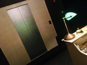In-game: An elevator door viewed from the front desk.