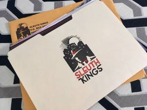 In-game: a Sleuth Kings file folder filled with clues.