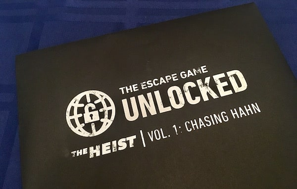 The sealed black envelope for The Escape Game Unlocked, The Heist Vol 1: Chasing Hahn.