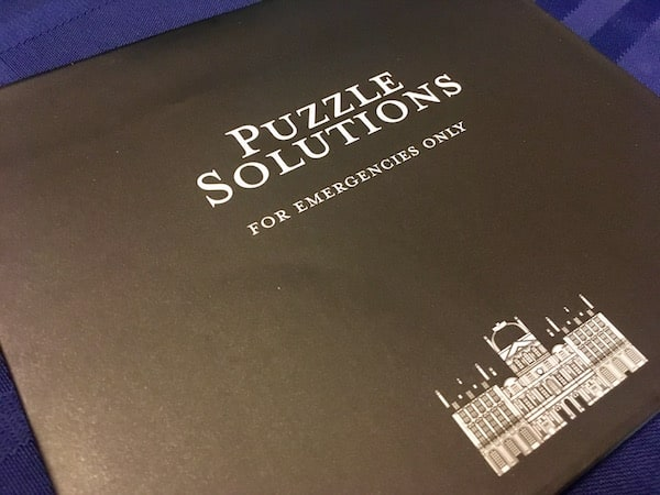 "An envelope labeled ""Puzzle Solutions for emergencies only"""