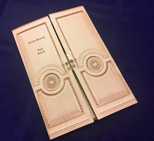 The ornate white doorway card for our room.