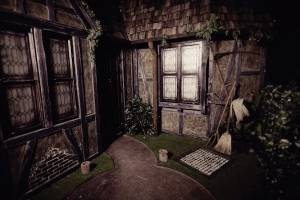 In-game: The exterior of a beautiful old home that shows signs of disrepair.