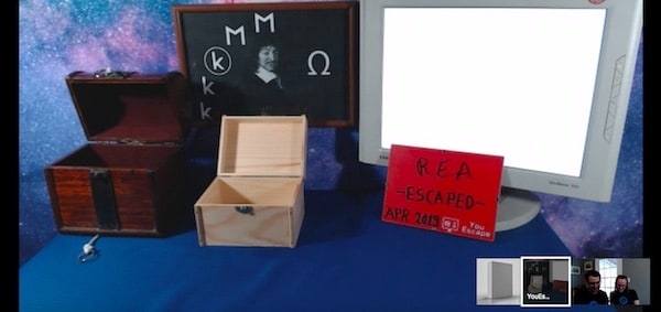 "Post-game screenshot of all of the boxes opened, a sign reads ""REA Escaped April 2019"""