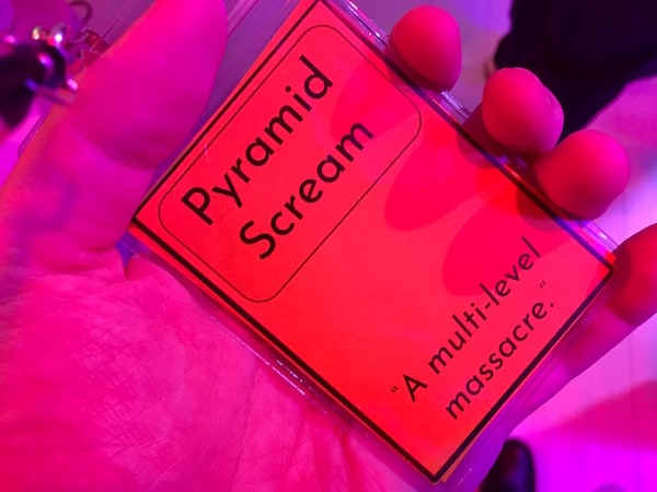 "In-game: the character card for ""Pyramid Scream."" It's subtitled, ""A multi-level massacre."""