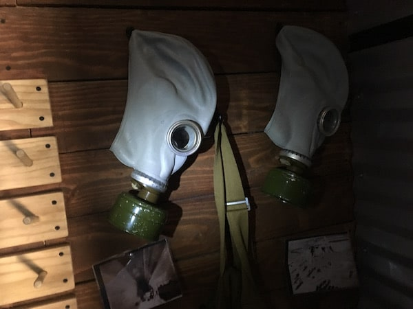 In-game: Closeup of of a pair of gas masks.