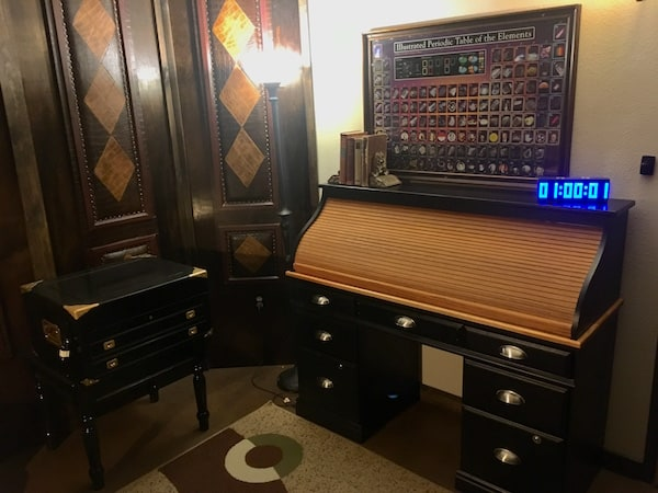 In-game: A rolltop desk in a very luxurious leather walled office.