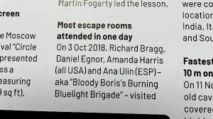 """Part one of the print entry reads: """"Most escape rooms attended in one day. On 3 Oct 2018, Richard Bragg, Daniel Egnor, Amanda Harris (all USA) and Ana Ulin (ESP) - aka """"Bloody Boris's Burning Bluelight Brigade"""" - visited"""""""