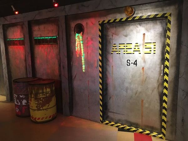 The entryway to Area 51 S-4. The walls are metal, and there is radio active material off to the side.