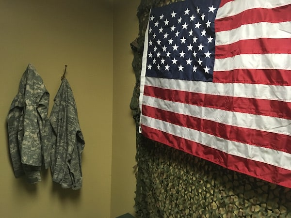 In-game: A pair of camo jackets beside an american flag.