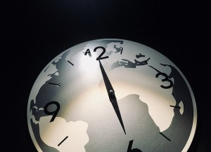In-game: a gray-scale clock depicting the Earth