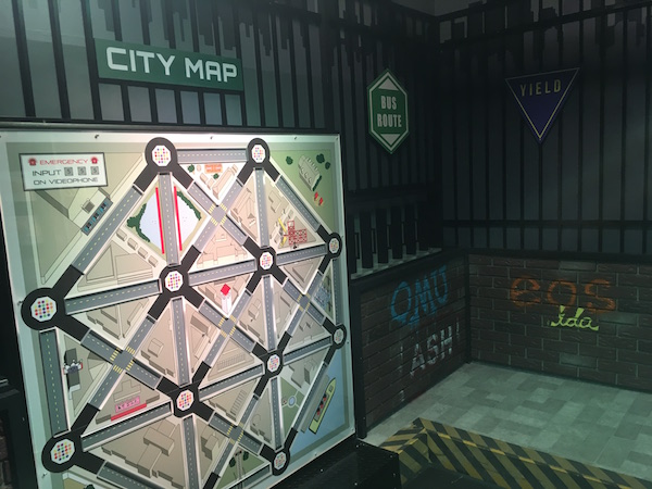 In-game: The city streets set with graphittied and a massive city map.