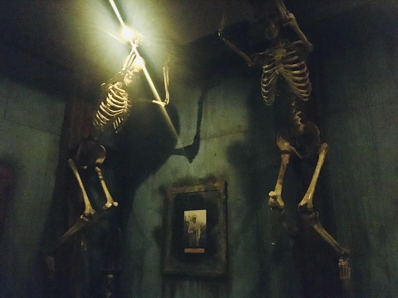 In-game: Two skeletons mounted to beams on the wall.