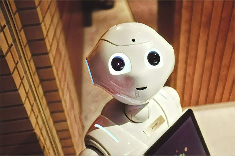 A friendly looking robot looking up into the camera.