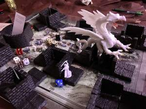 The game map, characters, dice, buildings, and a white dragon strewn about the map.