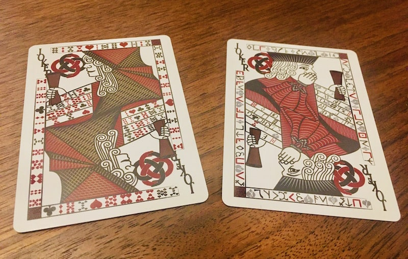 The Jokers from Carte Rouge are covered in intricate ciphers.