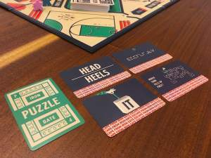 Puzzle card examples including some wordplay puzzles, a cipher, and a reasoning challenge.