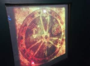 In-game: A wall with a glowing set of symbols set in a circle.