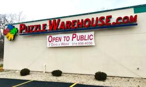 Puzzle Warehouse exterior and sign.