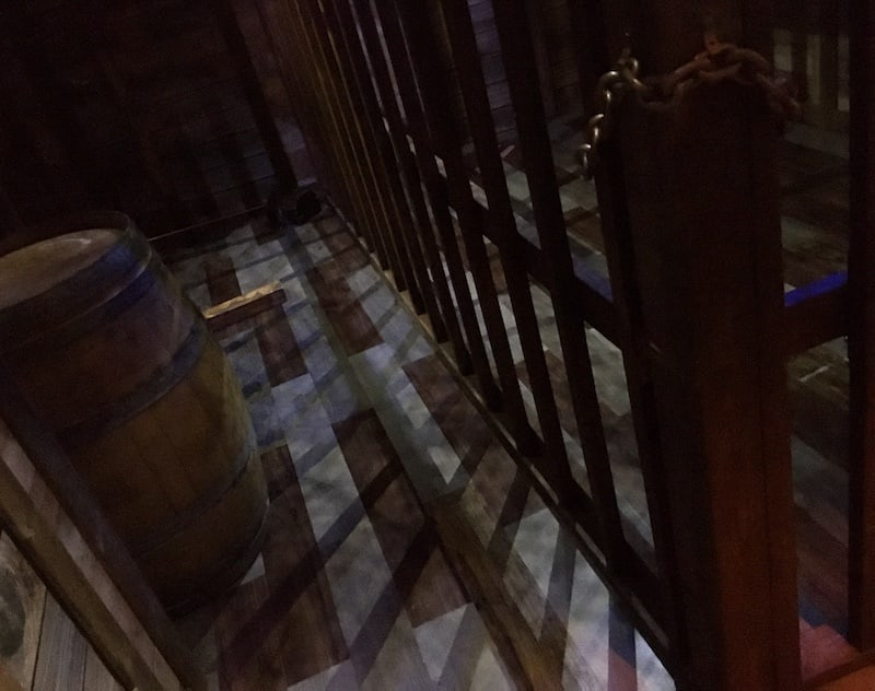 In-game: the brig inside of a wooden ship.