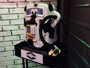 In-game: A toy gas pump painted like a cow.
